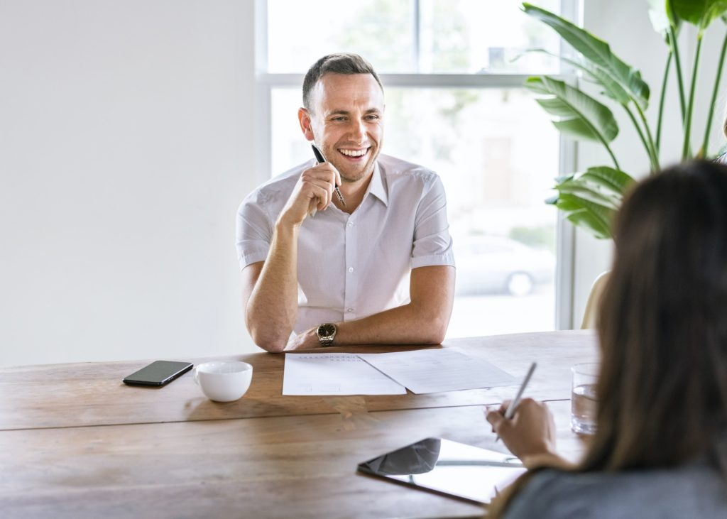 Happy businessman in a meeting